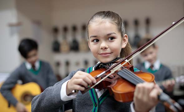 Prince's Gardens pupil playing the violin